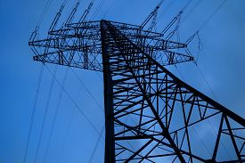 picture of electricity pylon  - Electricity pylon at a power station with blue background - JPG