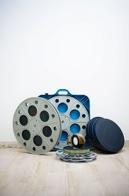 picture of mm  - Heap of old 35 mm cinema movie reels with blue professional boxes vertical frame - JPG
