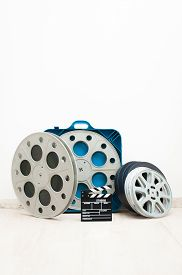 pic of mm  - Movie clapper board and 35 mm cinema reels with film and blue box - JPG