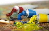 Oil Paint Tubes And Painbrush