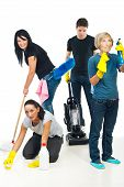 picture of cleaning service  - Four people teamwork working in a house and using cleaning products - JPG