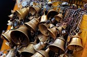 Many Metal Sacrificial Bells Hanging On Chain, Kathmandu, Nepal