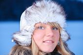 Beautiful Young Woman In Furry Hat At Winter Evening poster