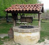 stock photo of bottomless  - old well in the ancient village to collect drinking water - JPG