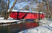 picture of covered bridge  - covered bridge in a city park adorned with Christmas lights - JPG