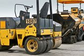 picture of heavy equipment  - Road construction roller heavy equipment machinery yellow - JPG