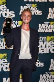 LOS ANGELES - JUN 5:  Tom Felton in the press room of the 2011 MTV Movie Awards at Gibson Ampitheatr