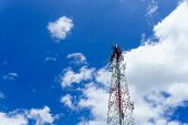 Telecommunication Tower For Radio Wave Or Mobile Cellular With Beautiful Clear Blue Sky And Little C poster
