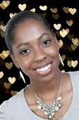 foto of african american hair styles  - A very beautiful African American black woman teenager with a big smile with heart bokeh - JPG
