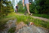 Businessmen Walking On Footpath By Lit Tealight Candle In Forest poster