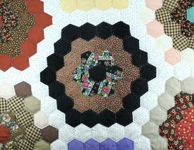 stock photo of scrappy  - Handmade colorful padded pattern patchwork folksy multicolored quilt - JPG