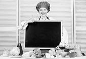 Giving Her Approval. Pretty Woman Gesturing Thumbs Up With Empty Blackboard. Master Cook At Cooking  poster