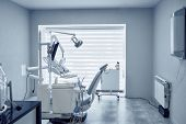 View From Side Of Professional Dental Equipment And Modern Tools In Dentist Office. Computer, Device poster