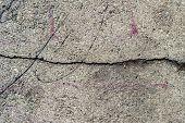 Old Road Background Surface Of Gray Cracked Asphalt Texture Closeup. Old Cracked Asphalt poster