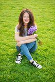 Spring Surprise. Woman Enjoy Relax Green Grass Background. Lady Enjoy Tender Flowers Bouquet. Femini poster