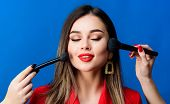Makeup Courses. Gorgeous Lady Make Up Red Lips. Attractive Woman Applying Makeup Brush. Perfect Skin poster