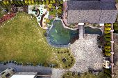 Aerial View Of Beautifully Landscaped Property Complex. Roofs Of Recreation House Cottage, Pond In E poster