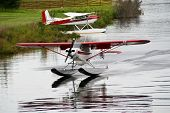 stock photo of float-plane  - Photo of a float plane taking off from an Alaskan river - JPG
