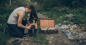 Homeless Father And Daughter Are In Garbage Dump Next To A Suitcase With Flowers Inside. The Concept poster