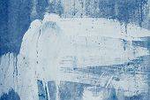 Smeared White Paint Stains On The Blue Wall. Drips Of White Paint On The Blue Canvas. Abstract Patte poster