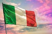 Fluttering Italy Flag On Colorful Cloudy Sky Background. Italy Prospering Concept. poster