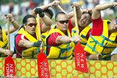 FLUSHING, NY - AUGUST 10:  Members of the Dragonflies dragon boat team compete on Meadow Lake at Flu