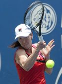 Jelena Jankovic of Serbia return ball to Petra Martic