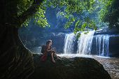Beautiful Girl With Waterfall.  Young Woman In Front Of Waterfall. Woman Relaxing In Natural Waterfa poster
