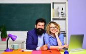 Young Male Teacher With Female Student Over Green Chalkboard Background. Back To School. Teachers In poster