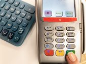 Woman Pressing Green Button On A Silver Payment Machine. Closeup Of Bank Payment Terminal. Processin poster