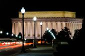 Lincoln Memorial with car taillight on Arlington Bridge at night, Washington DC USA