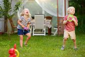 Cute Little Boy And Girl Playing In Game Throwing Rings At Summer Outdoors. Games For Family With Ki poster
