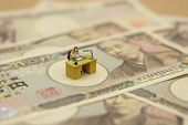 Miniature People Businessmen Sitting  With Japanese Banknotes Worth 10,000 Yen Using As Background B poster