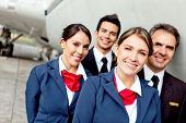 stock photo of cabin crew  - Cabin crew team with pilots and flight attendants smiling - JPG