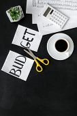 Sciccors And Paper With Word Budget, Coffee And Plan For Budget Reducing On Black Background Top Vie poster