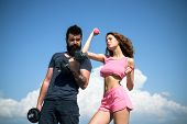 Start Daily Workout. Sexy Slim Active Couple With Straight Body Sportswear Outdoor Blue Sky Backgrou poster