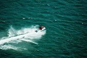 picture of waverunner  - a personal wataercraft racing down the colorado river