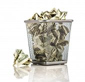 Money in a basket on a white background