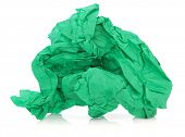 Green tissue paper in a crumpled up ball over white background.