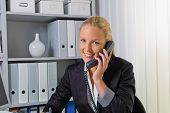 a friendly woman telephoned at her desk in the office and recorded events in the calendar