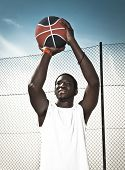 Portrait of a afroamerican man playing basketball in outdoor poster