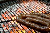 image of braai  - Tradtional South African braai barbecue borewors sausage on fire - JPG