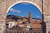 stock photo of aqueduct  - View of the Los Arcos Aqueduct with town buildings to the rear Teruel Teruel Province Aragon Spain Western Europe - JPG