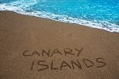 Brown beach sand with written word Canary islands
