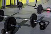 Kettlebells at gym with lifting bar weights fitness equipment