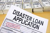 foto of cashiers  - Approved disaster loan application form and dollar bills at cashier - JPG