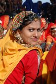 Portrait of young rajasthani girl who is preparing to dance perfomance at annual camel fair holiday