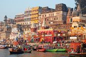 Indian people are walking near ghats after ceremony of daily morning bathing in the Ganges River
