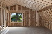 stock photo of reinforcing  - Room addition construction with pitched ceiling and garden view window - JPG