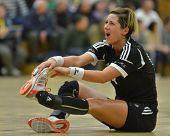 SIOFOK, HUNGARY - JANUARY 5: Annamaria Bogdanovic injured at a Hungarian National Championship handball match Siofok KC (black) vs. Budapest SE (white) January 5, 2013 in Siofok, Hungary.